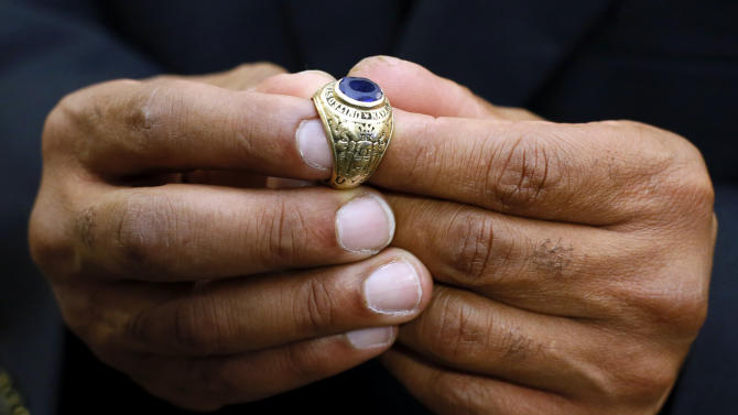 Wesley Brown, Jr., holds a class ring that belonged to his father, Lt. Cmdr. Wesley Brown, the first African-American to graduate from the United States Naval Academy, after a memorial service in Annapolis, Md., Wednesday, June 6, 2012. Brown, whose family donated the ring to the Academy, was a veteran of World War II, the Korean War and the Vietnam War before retiring from the Navy in 1969. Brown died last month of cancer. He was 85. (AP Photo/Patrick Semansky)