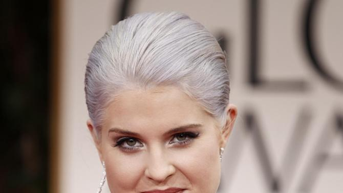 FILE - In this Jan. 15, 2012 file photo, TV personality Kelly Osbourne arrives at the 69th Annual Golden Globe Awards in Los Angeles. Gray heads have been popping up on runways and red carpets, on models and young celebrities for months. There's Lady Gaga and Kelly Osbourne _ via dye _ and Hollywood royalty like Oscar-winning British actress Helen Mirren. (AP Photo/Matt Sayles, file)