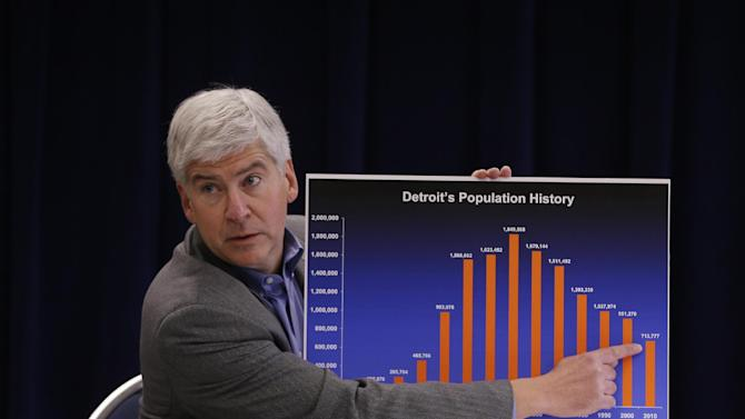 FILE - In this Feb. 21, 2013 file photo, Michigan Gov. Rick Snyder discusses the effect of Detroit's drastic population loss over 60 years, which he says is the main reason for the city's financial woes during a news conference at his office in Detroit. Snyder said Friday, March 1, that he has declared a financial emergency in Detroit, a determination that could lead to the appointment of an emergency manager over the city's finances. (AP Photo/Carlos Osorio, File)