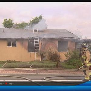 Firefighters knock down 2 alarm house fire in Clairemont