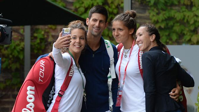 TEN: Serbia's Novak Djokovic and Jelena Jankovic pose for a selfie with junior players