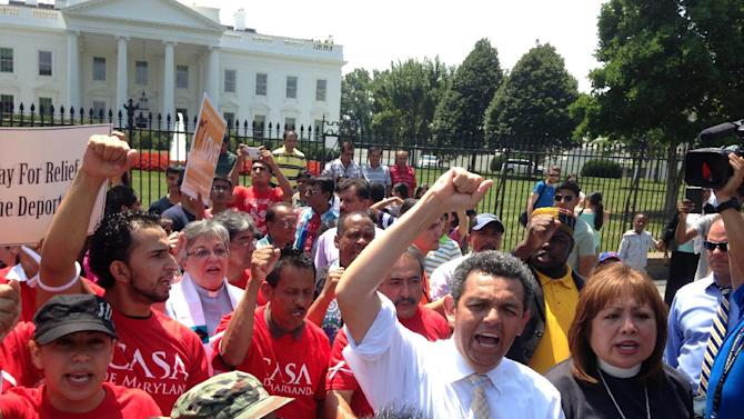 FILE - In this July 31, 2014, file photo, faith leaders and activists participates in a demonstration in front of the White House in Washington, asking President Barack Obama to modify his deportation policies. Obama is considering key changes in the legal immigration system requested by tech, industry and powerful interest groups. Administration officials and advocates say those steps would go beyond the expected relief from deportations for some immigrants in the U.S. illegally that Obama signaled he'd pursue after immigration efforts in Congress collapsed. (AP Photo/Luis Alonso Lugo, File)