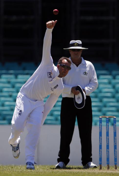 England's Swann bowls during their warm-up match against the Cricket Australia Invitational XI at the Sydney Cricket Ground