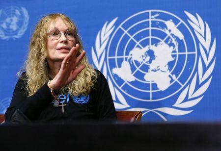 US actress and UNICEF Goodwill ambassador Farrow gestures during a news conference at the UN in Geneva