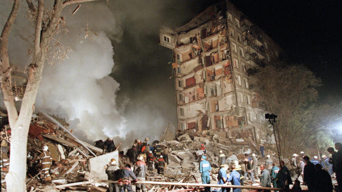 FILE - In this early Thursday, Sept. 9, 1999 file photo smoke rises from an apartment building destroyed by a bomb blast blamed on Chechen militants, as Russian Emergency Situations Ministry officers and firefighters try to save people in Moscow.  Two suspects in the Boston Marathon bombing have been identified to The Associated Press as coming from a Russian region near Chechnya In the past, insurgents from Chechnya and neighboring restive provinces in the Caucasus have been involved in terror attacks in Moscow and other places in Russia. (AP Photo/Ivan Sekretarev, file)