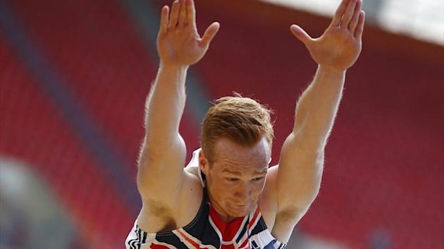 Greg Rutherford of Britain competes in the men's long jump qualifying round during the IAAF World Athletics Championships at the Luzhniki stadium in Moscow August 14, 2013 (Reuters)