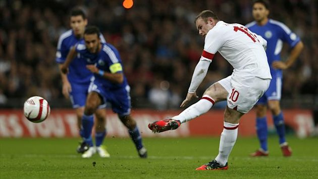 England's Wayne Rooney shoots to score England's first goal from a penalty kick during their 2014 World Cup qualifying match against San Marino at Wembley Stadium in London October 12, 2012