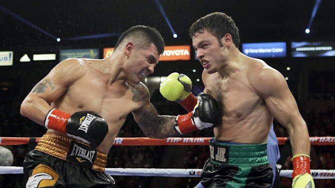 CORRECTS SPELLING OF FIRST NAME TO BRYAN - Bryan Vera lands a left to Julio Cesar Chavez Jr. in the fourth round of a 10-round boxing match between Chavez, the former World Boxing Council (WBC) middleweight champion, and Vera, the contender, in Carson, Calif., Saturday, Sept. 28, 2013. Chavez won in a unanimous decision