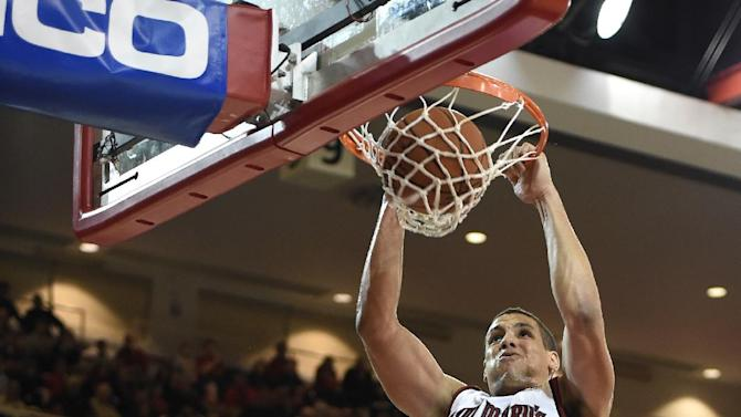 St. Mary's Brad Waldow (00) dunks a basket over St. John's forward Christian Jones (4) during the first half of an NCAA college basketball game on Friday, Dec. 19, 2014, in New York. (AP Photo/Kathy Kmonicek)