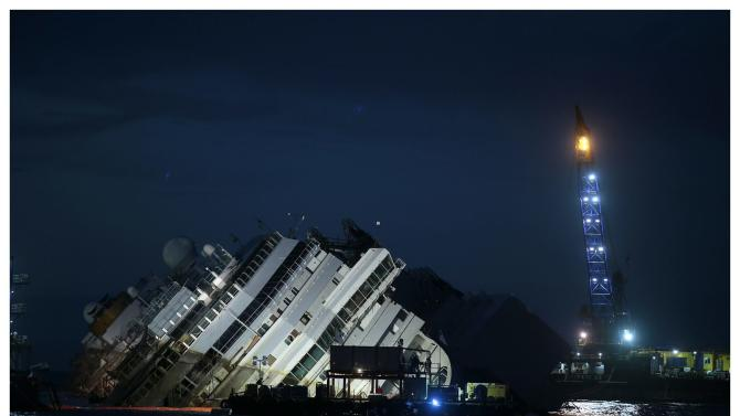 """The capsized cruise liner Costa Concordia is shown in this combination picture taken during and at the end of the """"parbuckling"""" operation outside Giglio harbour"""