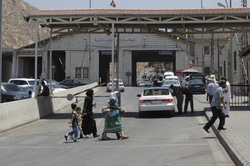 Syrians arrive at the Lebanese-Syrian border in al-Masnaa in July 2012. Lebanon deported 14 Syrians on Wednesday despite the raging violence over the border, drawing criticism from human rights activists