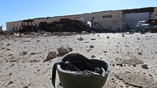 A helmet that belonged to Islamic State militants is seen on the ground at the 121 Regiment base after Fighters from the Democratic Forces of Syria took control of the base in the town of al-Melabiyyah, south of Hasaka city, Syria