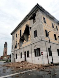 The facade of the town hall is damaged after a powerful earthquake that shook Italy&#39;s industrial and densely populated northeast. Authorities evacuated about 3,000 people from the Emilia Romagna region, where a magnitude 6.0 quake struck early Sunday, killing at least six