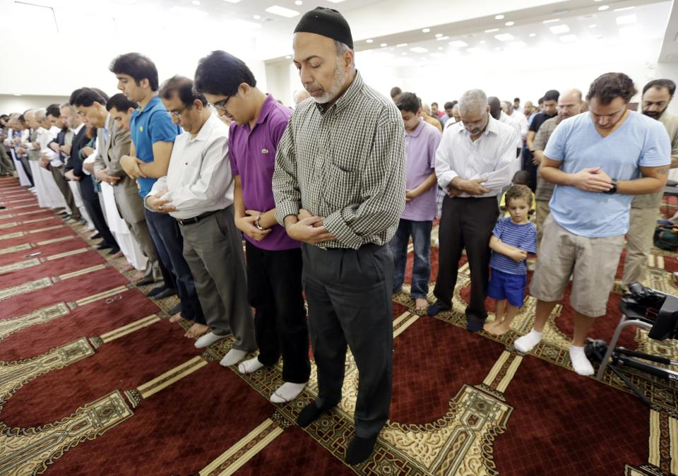 Naim Mohammed, center, worships with others during midday prayers at the Islamic Center of Murfreesboro on Friday, Aug. 10, 2012, in Murfreesboro, Tenn. Opponents of  the mosque waged a two-year court battle trying to keep it from opening. (AP Photo/Mark Humphrey)