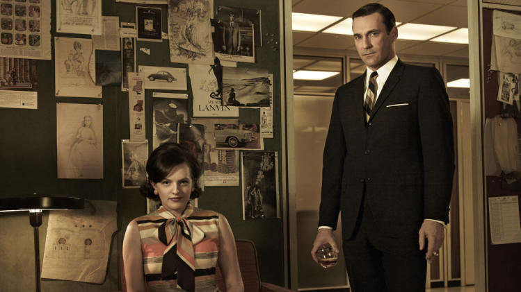 "Elisabeth Moss as Peggy Olson and Jon Hamm as Don Draper in ""Mad Men."""