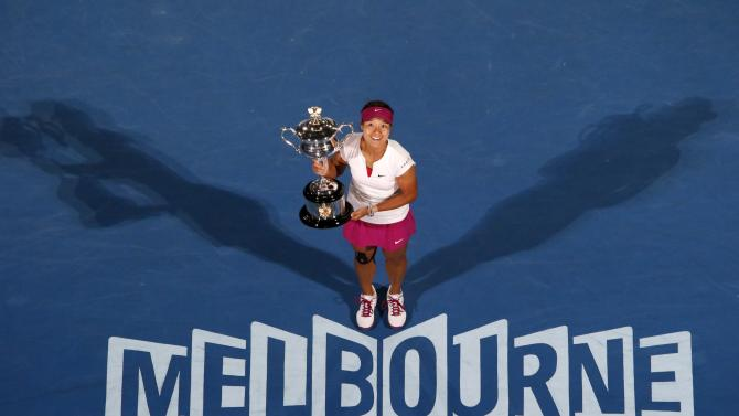 File photo of Li Na of China posing with The Daphne Akhurst Memorial Cup after defeating Dominika Cibulkova of Slovakia in their women's singles final match in Melbourne
