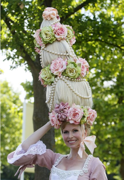 Model Anneka-Tanaka-Svenska poses for the media in a lavish costume and head piece on the first day of the Royal Ascot horse race meeting at Ascot, England, Tuesday, June, 14, 2011.  Ascot  is celebra