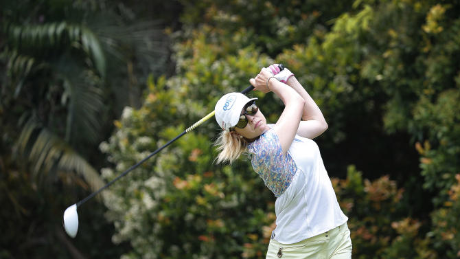 Paula Creamer of the United States tees off on hole twelve during the first round of the HSBC Women's Champions golf tournament on Thursday, March 5, 2015 in Singapore. (AP Photo/Wong Maye-E)