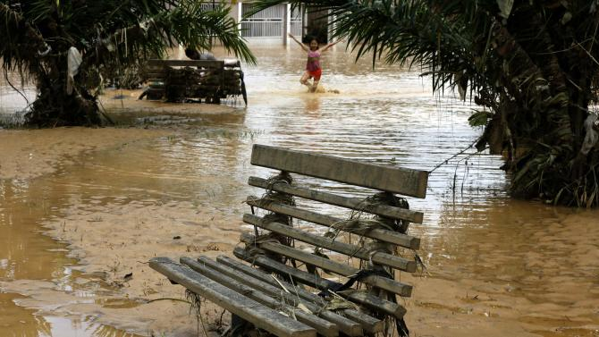 A park bench stands in flood waters in Brasileia, bordering Bolivia