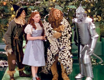 The Scarecrow ( Ray Bolger ), Dorothy ( Judy Garland ), the Cowardly Lion ( Bert Lahr ) and the Tin Man ( Jack Haley ) in Warner Home Entertainment's DVD release of The Wizard of Oz