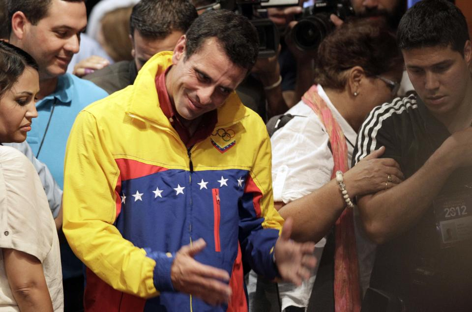 Opposition presidential candidate Henrique Capriles leaves the stage after he conceded defeat in the presidential elections at his campaign headquarters in Caracas, Venezuela, Sunday, Oct. 7, 2012.  Venezuela's electoral council said late Sunday President Hugo Chavez has won re-election, defeating challenger Henrique Capriles. (AP Photo/Ariana Cubillos)