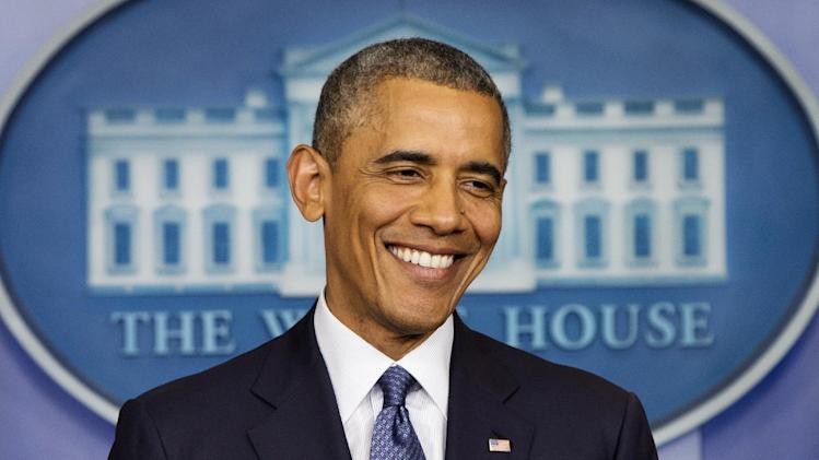 President Barack Obama smiles as he nears the conclusion of a news conference in the Brady Press Briefing Room of the White House in Washington, Friday, Aug. 1, 2014. The president spoke on various topics including the economy, immigration, Ukraine and the Middle East. (AP Photo/Jacquelyn Martin)