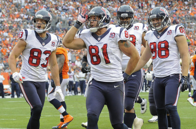 Houston Texans tight end Owen Daniels (81) celebrates with wide receiver Kevin Walter (83), outside linebacker Connor Barwin (98) and tackle Ryan Harris (68) after scoring a touchdown in the third quarter of an NFL football game Sunday, Sept. 23, 2012, in Denver. (AP Photo/Jack Dempsey)