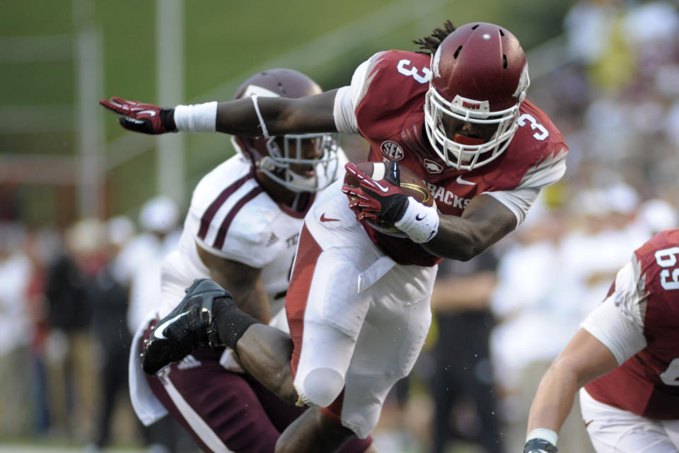 Manziel leads No. 10 Texas A&M past Arkansas 45-33
