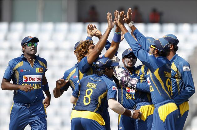 Sri Lanka's fielders celebrate with teammate Malinga as he dismissed Pakistan's Shehzad successfully during their 2014 Asia Cup final match in Dhaka