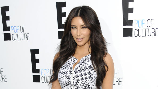 "FILE - In this April 30, 2012 file photo, Kim Kardashian from the show ""Keeping Up With The Kardashians"" attends an E! Network upfront event at Gotham Hall in New York. Kardashian's lawsuit against Old Navy over an advertisement was dismissed Tuesday Aug. 28, 2012 after the two sides reached a settlement. Kardashian sued the retailer last year, claiming they violated her publicity rights by using a lookalike in an ad. (AP Photo/Evan Agostini, File)"