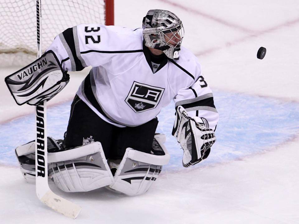 Los Angeles Kings goalie Jonathan Quick (32) keeps his eye on the puck during third period of game two of first round NHL Stanley Cup playoff hockey action against the Vancouver Canucks at Rogers Arena in Vancouver, British Columbia, Friday, April, 13, 2012. (AP Photo/The Canadian Press, Jonathan Hayward)
