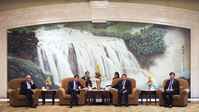 French Prime Minister Manuel Valls and Shanghai's mayor Yang Xiong talk during a meeting in Shanghai