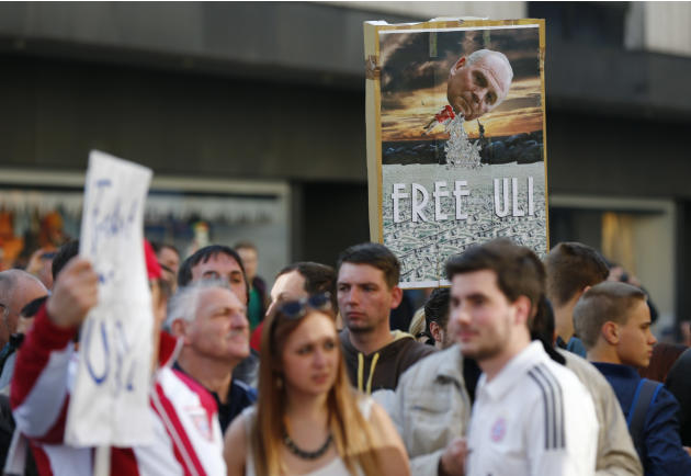 Supporters of Bayern Munich President Hoeness gather outside the regional court in Munich