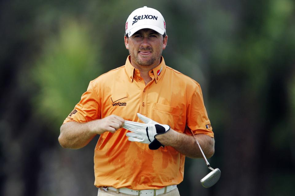 Graeme McDowell, of Northern Ireland, pulls off his glove after putting on the 11th green during a practice round for the PGA Championship golf tournament on the Ocean Course of the Kiawah Island Golf Resort in Kiawah Island, S.C., Wednesday, Aug. 8, 2012. (AP Photo/Lynne Sladky)