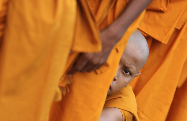 Buddhist monks attend the Vesak Day ceremony at the Udong mountain in Kandal