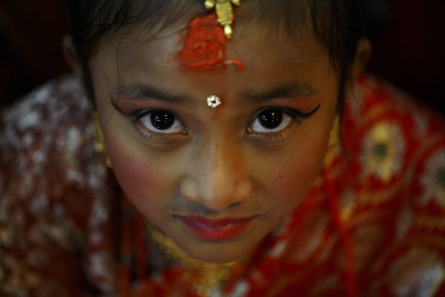 An adorned Newar girl is pictured while performing rituals during an Ihi ceremony in Kathmandu