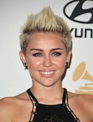 Singer Miley Cyrus arrives at the Clive Davis Pre-GRAMMY Gala on Saturday, Feb. 9, 2013 in Beverly Hills, Calif. (Photo by John Shearer/Invision/AP)