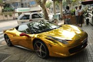 This file photo shows a gold colored Ferrari parked on a street in Shanghai, in July. China is set to become the world's second biggest market for luxury goods after the United States in five years, overtaking France, Britain, Italy and Japan, according to an industry report