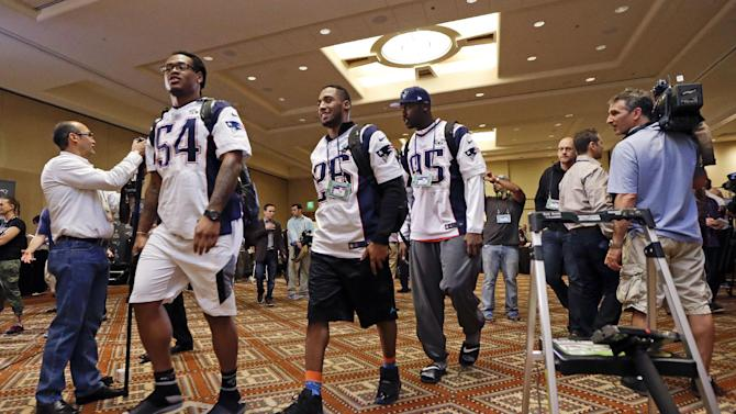 New England Patriots outside linebacker Dont'a Hightower (54), cornerback Logan Ryan (26), and defensive end Chandler Jones (95) leave the room at the end of the team's media availability Thursday, Jan. 29, 2015, in Chandler, Ariz. The Patriots play the Seattle Seahawks in NFL football Super Bowl XLIX Sunday, Feb. 1