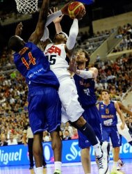 Carmelo Anthony, center, of the US Men's Senior National Team, left, dives for the ball against Pau Gasolof the Spain Men's Senior National Team, right, and Serge Ibakaduring an exhibition match between Spain and the United States Tuesday, July 24, 2012, in Barcelona, Spain, in preparation for the 2012 Summer Olympics. (AP Photo/Manu Fernandez)
