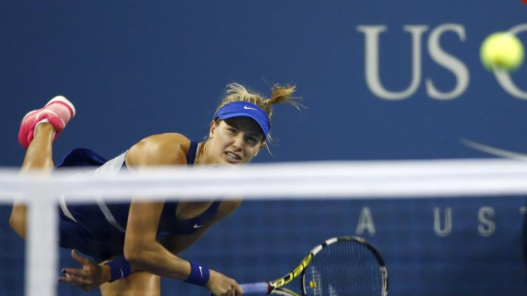 Eugenie Bouchard of Canada serves to Barbora Zahlavova Strycova of the Czech Republic during their women's singles match at the 2014 U.S. Open tennis tournament in New York