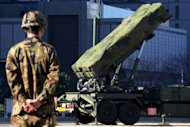 A Japanese Patriot Advanced Capability-3 missile launcher is set up outside the Defence Ministry in Tokyo on December 6, 2012. Japan and the US view North Korea's planned rocket launch as a disguised ballistic missile test banned under UN resolutions prompted by the North's nuclear tests in 2006 and 2009