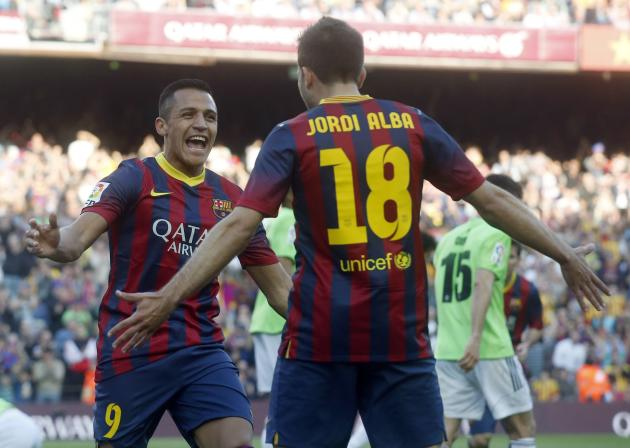 Barcelona's Alexis Sanchez and Jordi Alba celebrate a goal against Osasuna during their Spanish first division soccer match at Camp Nou stadium in Barcelona