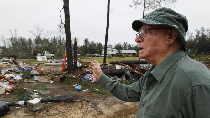 Charlie Higginbotham, Sr. speaks about what remains of his convenience store in Shuqualak, Miss., Thursday, April 11, 2013, after it was hit by a tornado. Higginbotham, 90, built the store in 1958 for his wife to run in the rural east Mississippi community and later it was turned into an apartment. (AP Photo/Rogelio V. Solis)