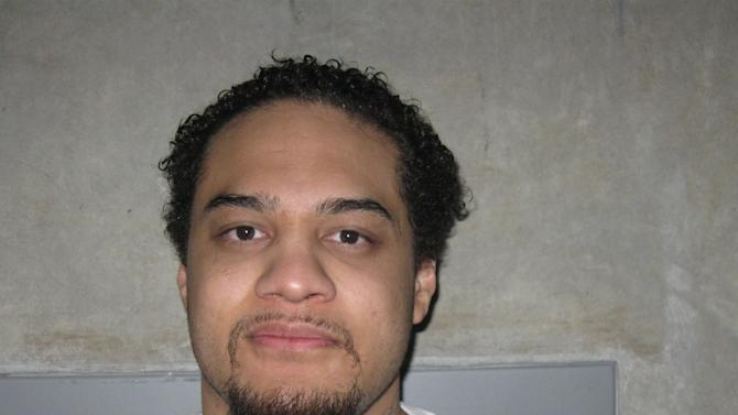 This Feburary 2012 photo, provided by the Utah Department of Corrections, shows Siale Angilau. A U.S. marshal shot and critically wounded Angilau on Monday, April 21, 2014, in a new federal courthouse after Angilau rushed the witness stand with a pen at his trial in Salt Lake City, authorities said. Angilau was one of 17 people named in a 29-count racketeering indictment filed in 2008 accusing gang members of conspiracy, assault, robbery and weapons offenses. The FBI said Angilau died Monday at the hospital. (AP Photo/Utah Department of Corrections)