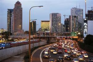 Vehicles drive on a highway in Tel Aviv