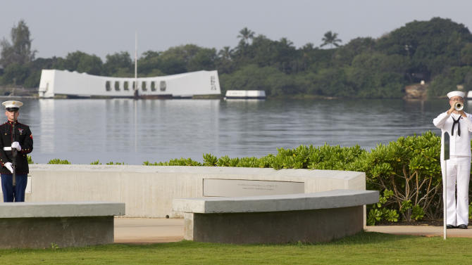 Taps are played during a ceremony commemorating the Japanese attack on Pearl Harbor Friday, Dec. 7, 2012, at Pearl Harbor, Hawaii. Pearl Harbor Veterans from all over the country gathered at the World War II Valor In The Pacific National Monument remembering the 71th anniversary of Dec. 7, 1941 surprise attack. (AP Photo/Eugene Tanner)