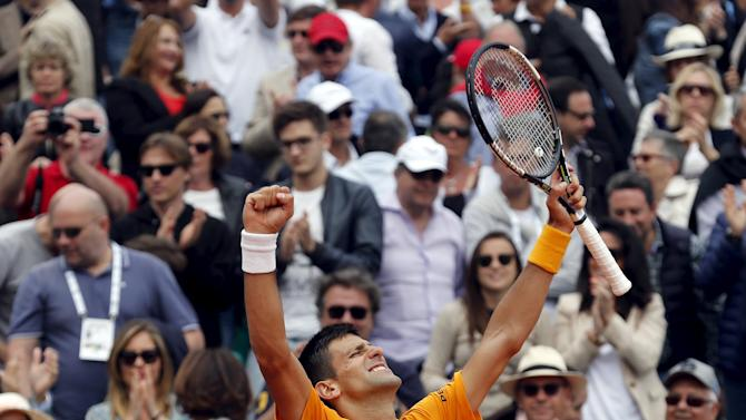 Djokovic of Serbia reacts after defeating Nadal of Spain during their semi-final match at the Monte Carlo Masters in Monaco