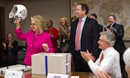 Clinton Returns To Work After Blood Clot Scare