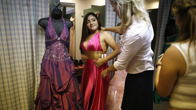 An event provides free prom dresses, shoes and accessories to homeless and low income school girls in Los Angeles